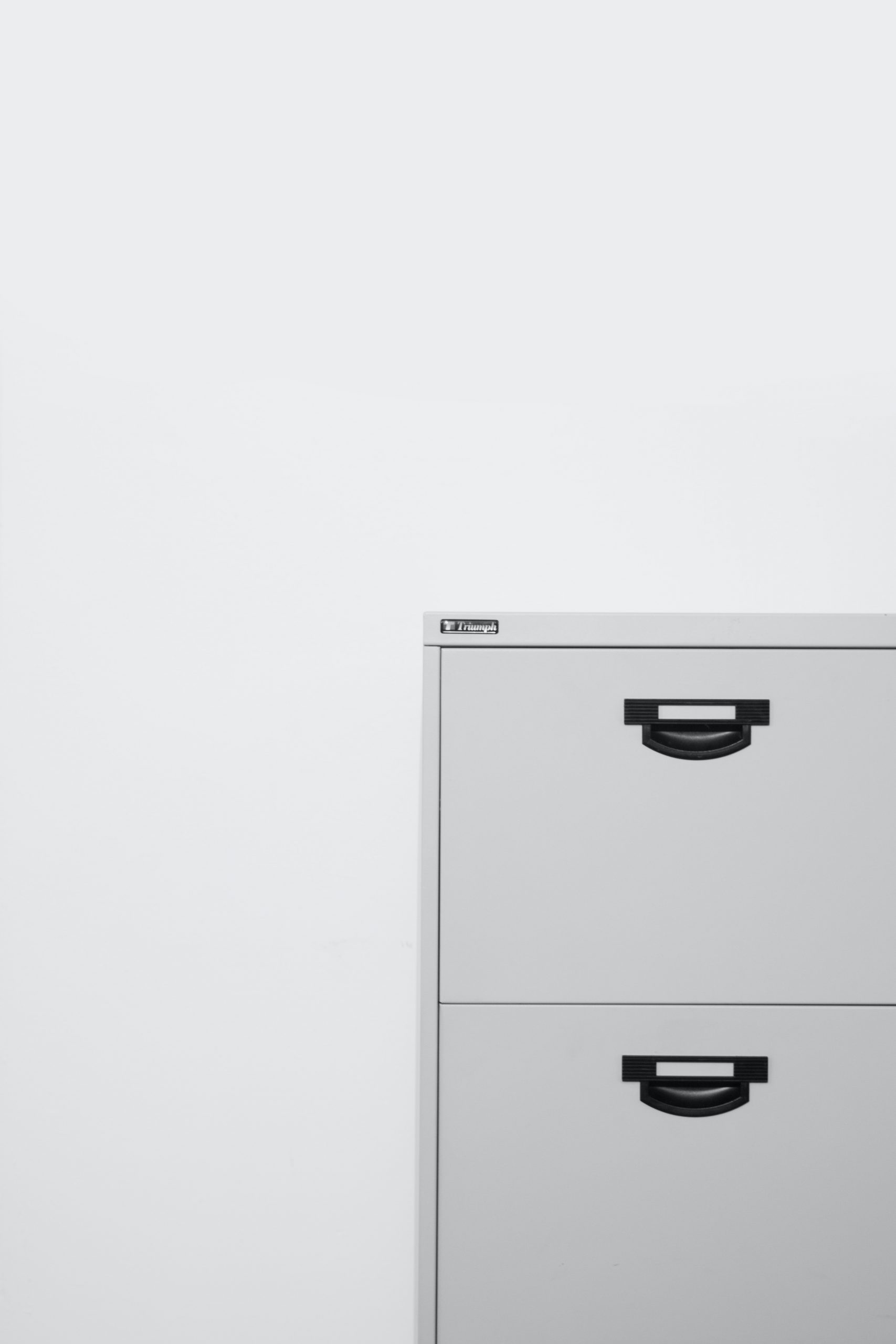 gray metal locker on white surface